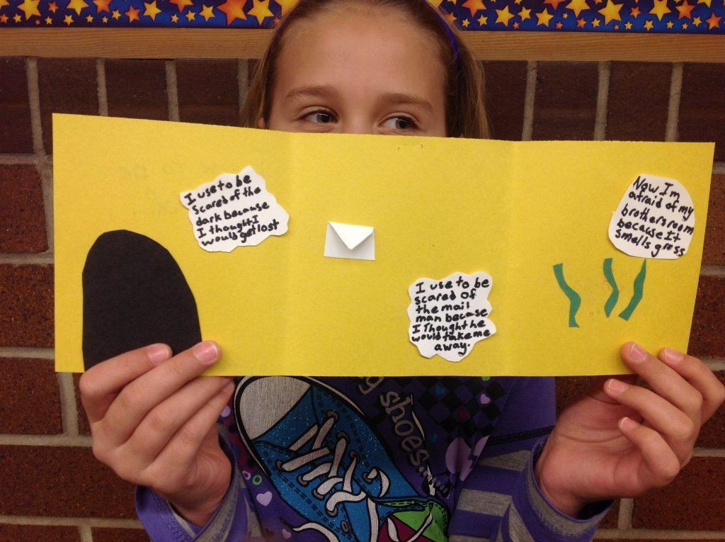 Student displaying poem at Hawthorne School